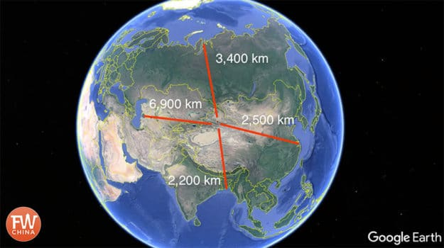 A world map showing the geographic center of Asia in Xinjiang