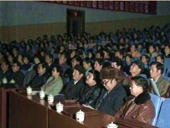 Officials seated in the front rows of the Karamay theater in 1994