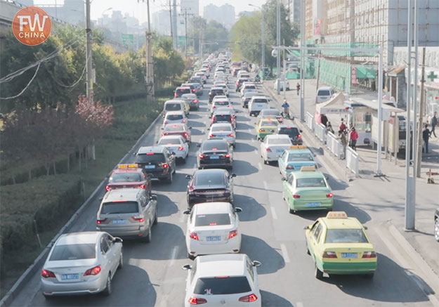 Driving in China on the roads full of traffic