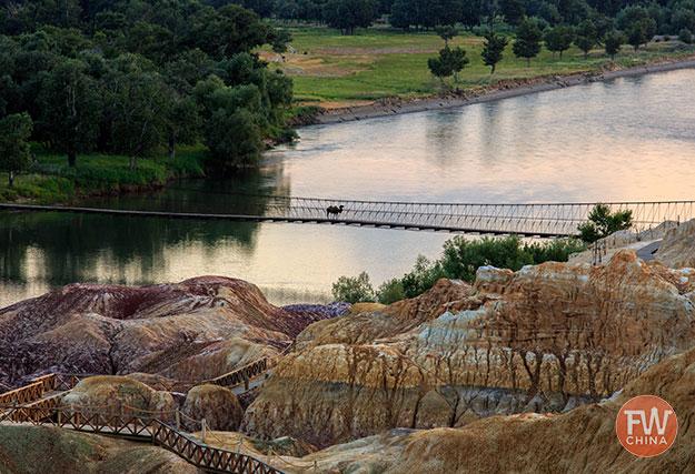 Wooden pathways and a bridge at Wucaitan in Xinjiang, China